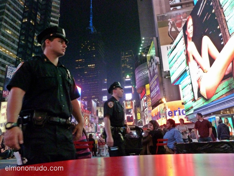 New York. Manhattan. Policemen in Times Square by night.